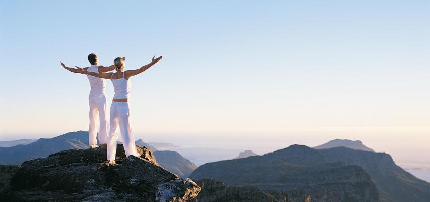 yoga couple mountain top